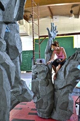Artist working on bronze sculpture